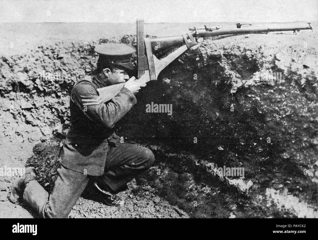 A periscope which enables a man to take deliberate aim over a trench-crest in security :marksmanship with the Walker periscope attachment. - Stock Image