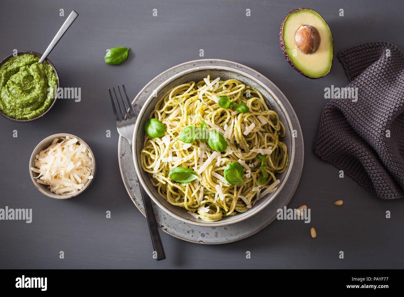 spaghetti pasta with avocado basil pesto sauce - Stock Image