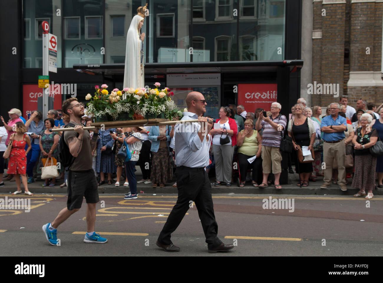 Christianity UK. Roman Catholic procession people Italian community annual procession Saint Peters,  St Peters Italian Church London people watching   HOMER SYKES Stock Photo
