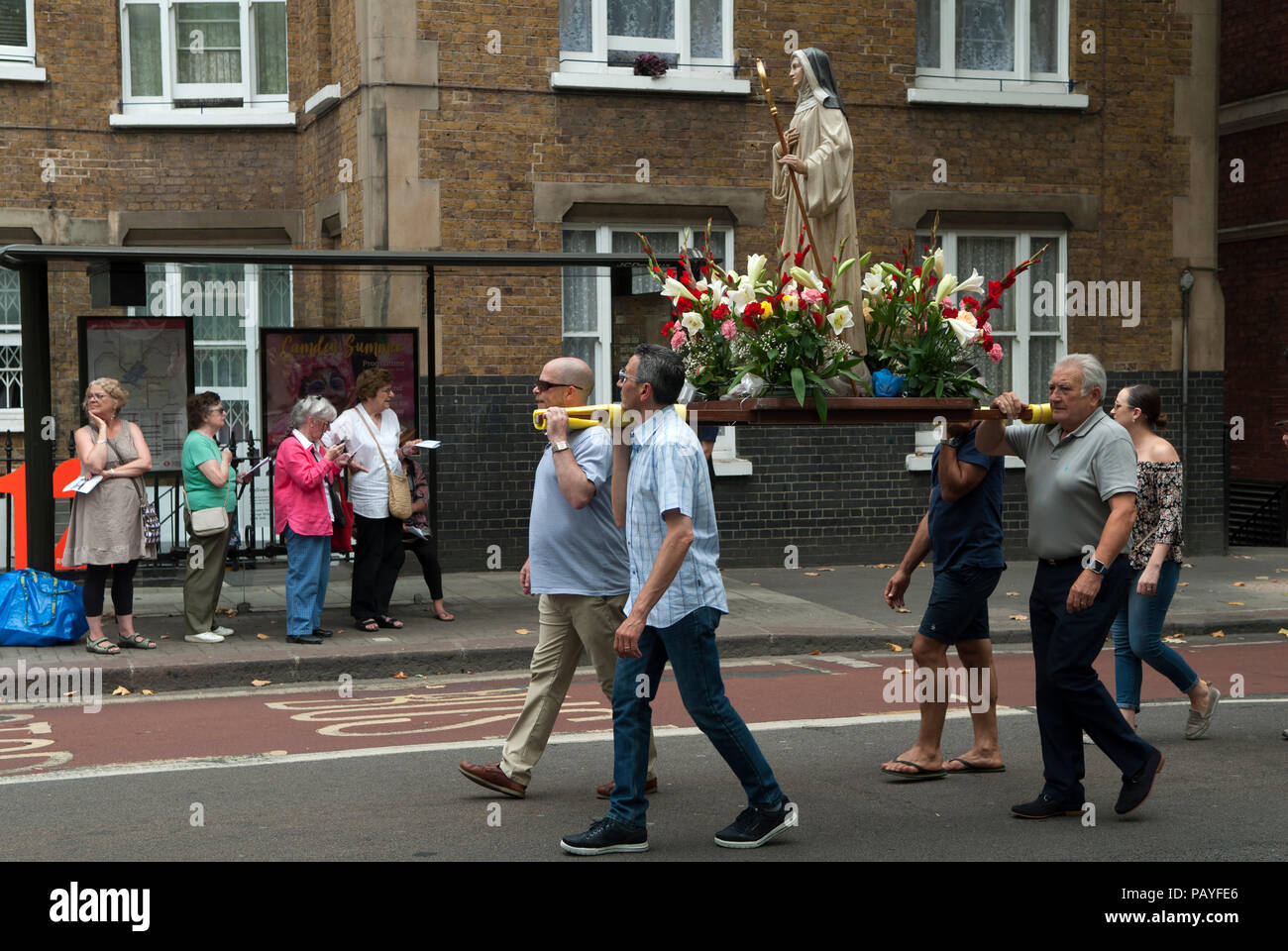 Roman Catholic procession Christianity UK. People Italian community annual procession Saint Peters,  St Peters Italian Church London people watching   HOMER SYKES Stock Photo