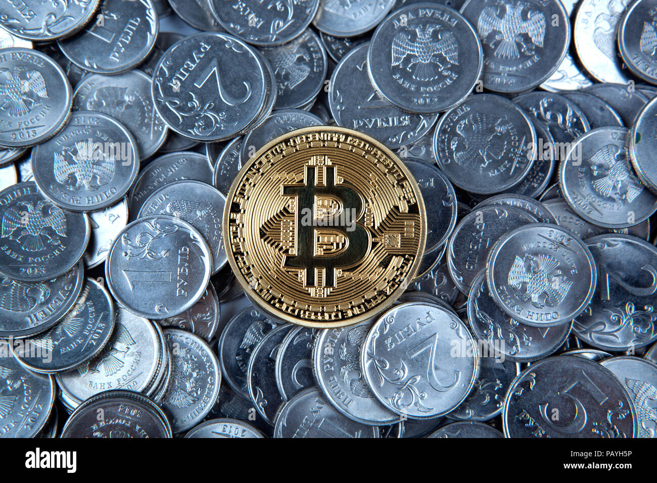 gold coin bitcoin on russian ruble coins close up - Stock Image