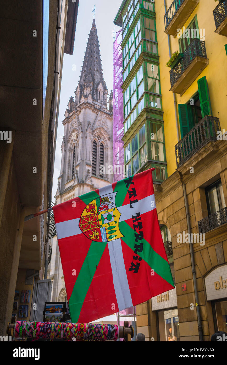 Bilbao street, view of a Basque (Euskadi) flag bearing a municipal coat of arms hanging in the center of the Casco Viejo (Old Town) area of Bilbao. - Stock Image