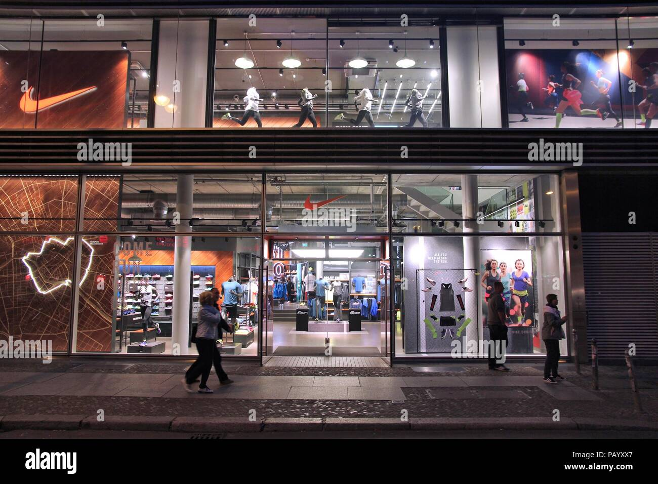 newest 76831 34459 BERLIN, GERMANY - AUGUST 25, 2014 People walk by Nike store in Berlin. As  of 2014 Nike Inc operates some 850 retail sports goods stores worldwide.
