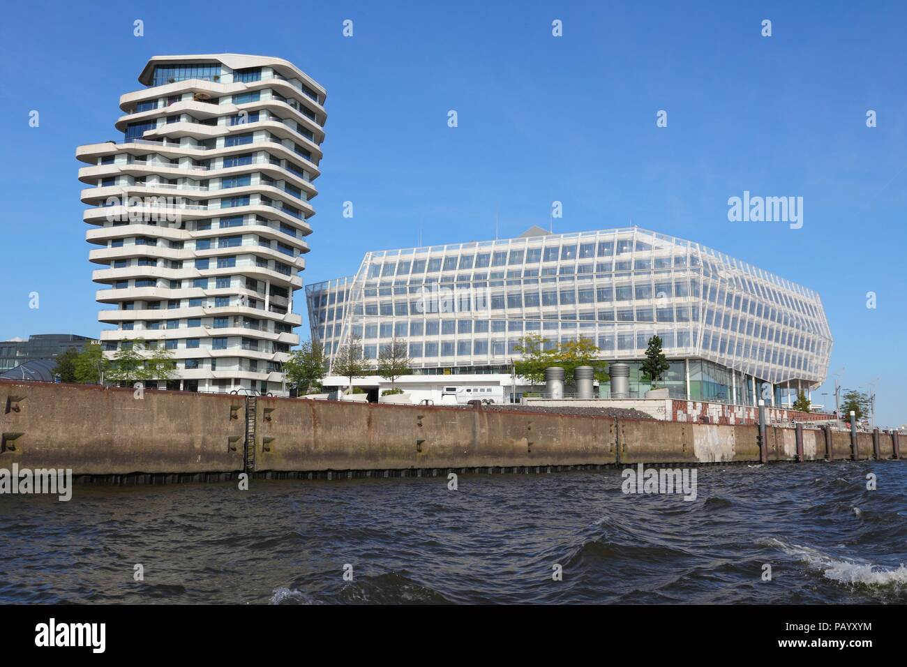 HAMBURG, GERMANY - AUGUST 28, 2014: Unilever Germany headquarters in Hamburg (the building on the right). Unilever is a British-Dutch consumer goods c - Stock Image