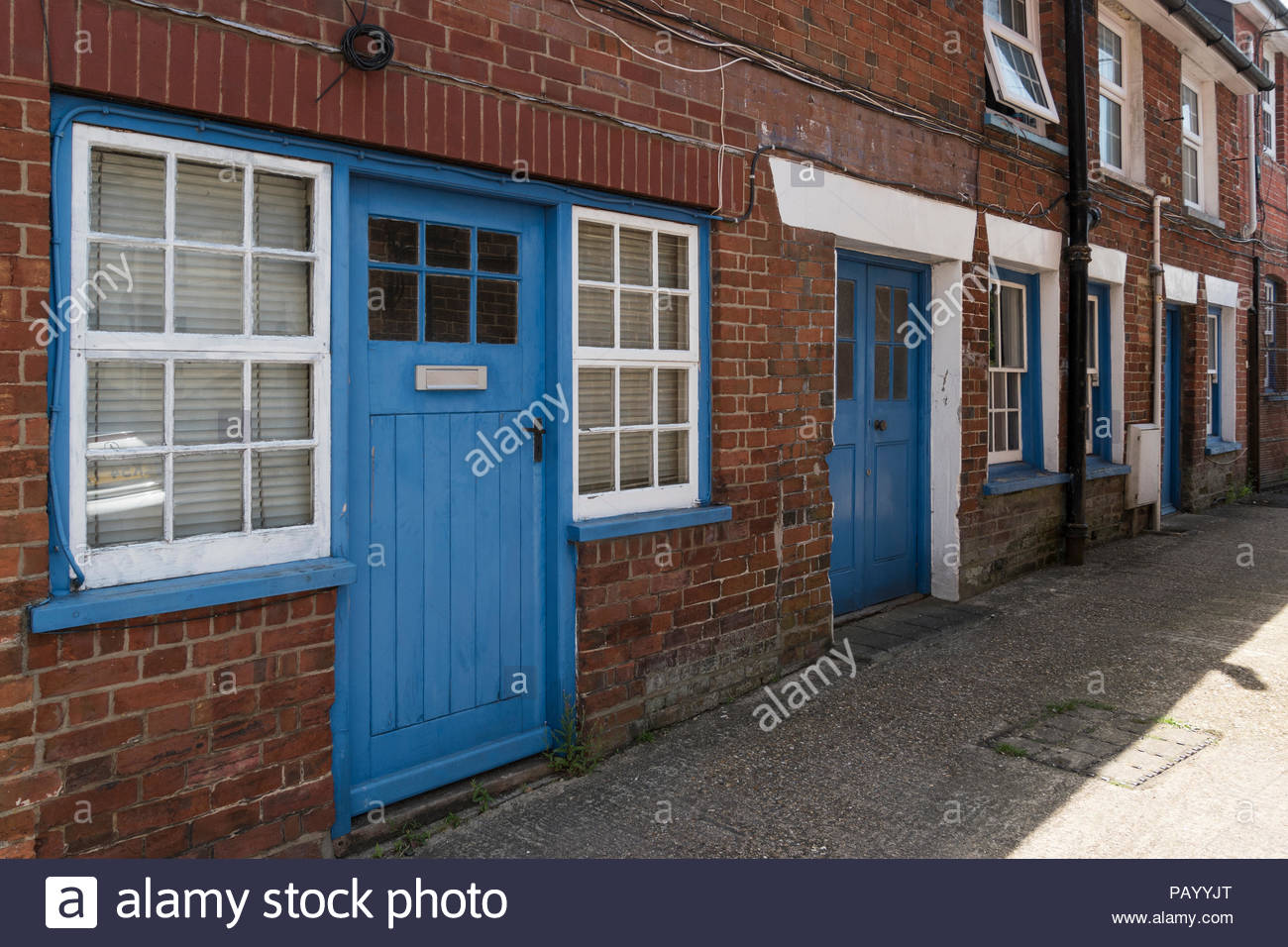 Row Of Terraced Houses With Blue Painted Front Doors Ringwood