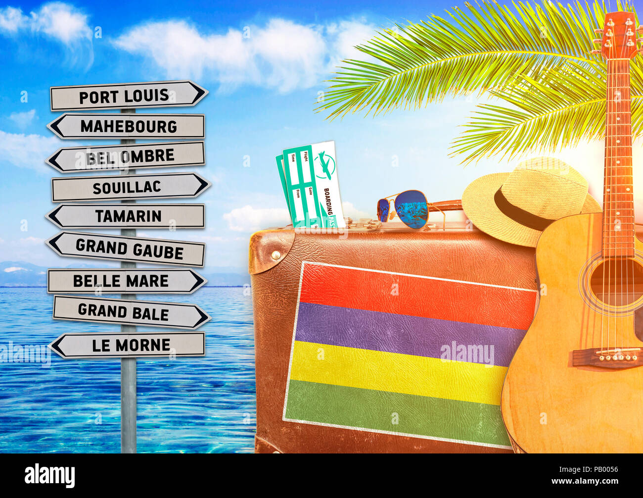 Concept of summer traveling with old suitcase and Mauritius town sign - Stock Image