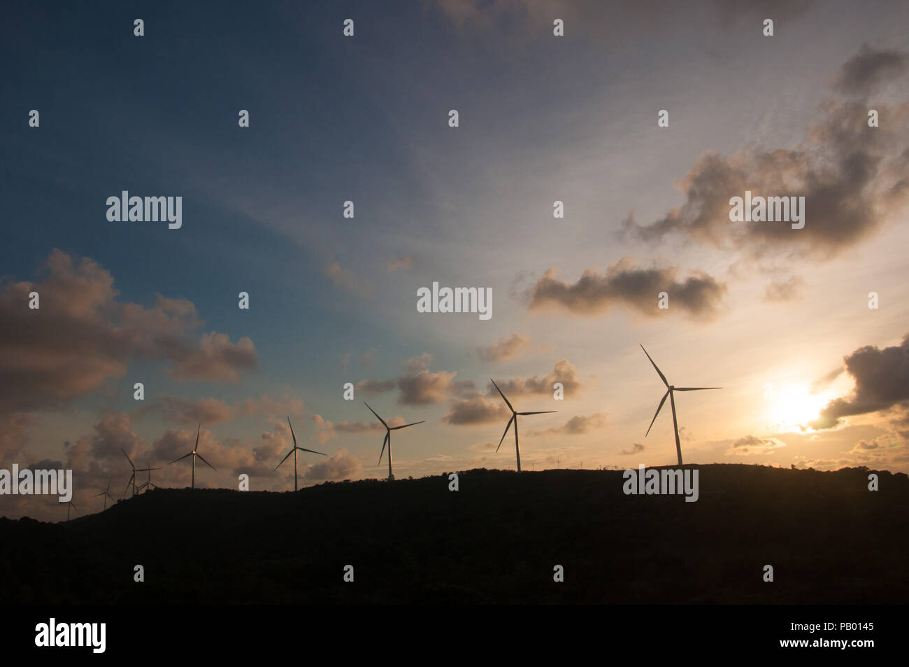 A line of wind turbines at the Sidrap Wind Farm site in Sidenreng Rappang, South Sulawesi, Indonesia - Stock Image