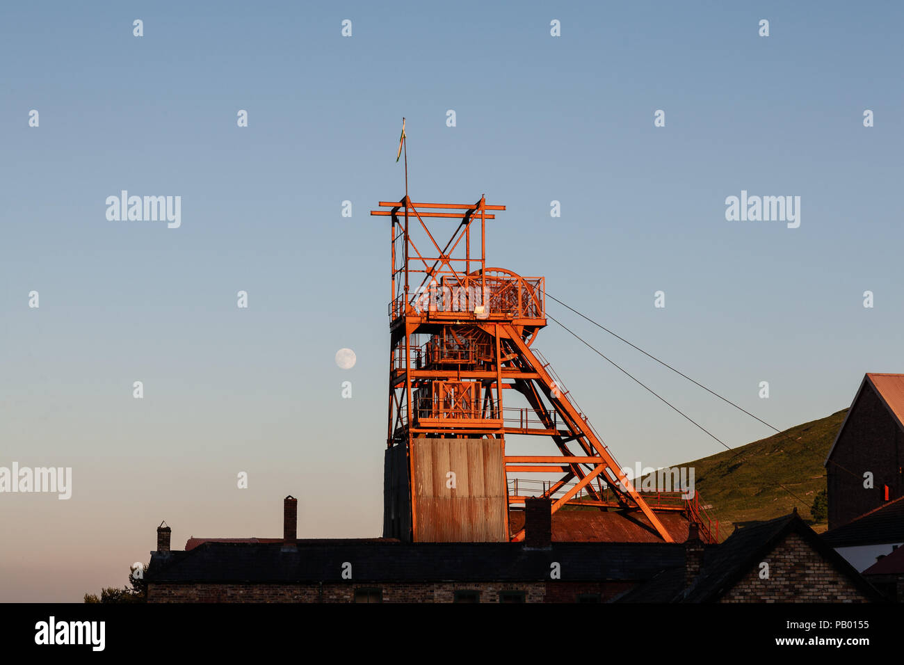 The headgear at the Big Pit National Coal Museum Blaenavon, with the moon behind. - Stock Image