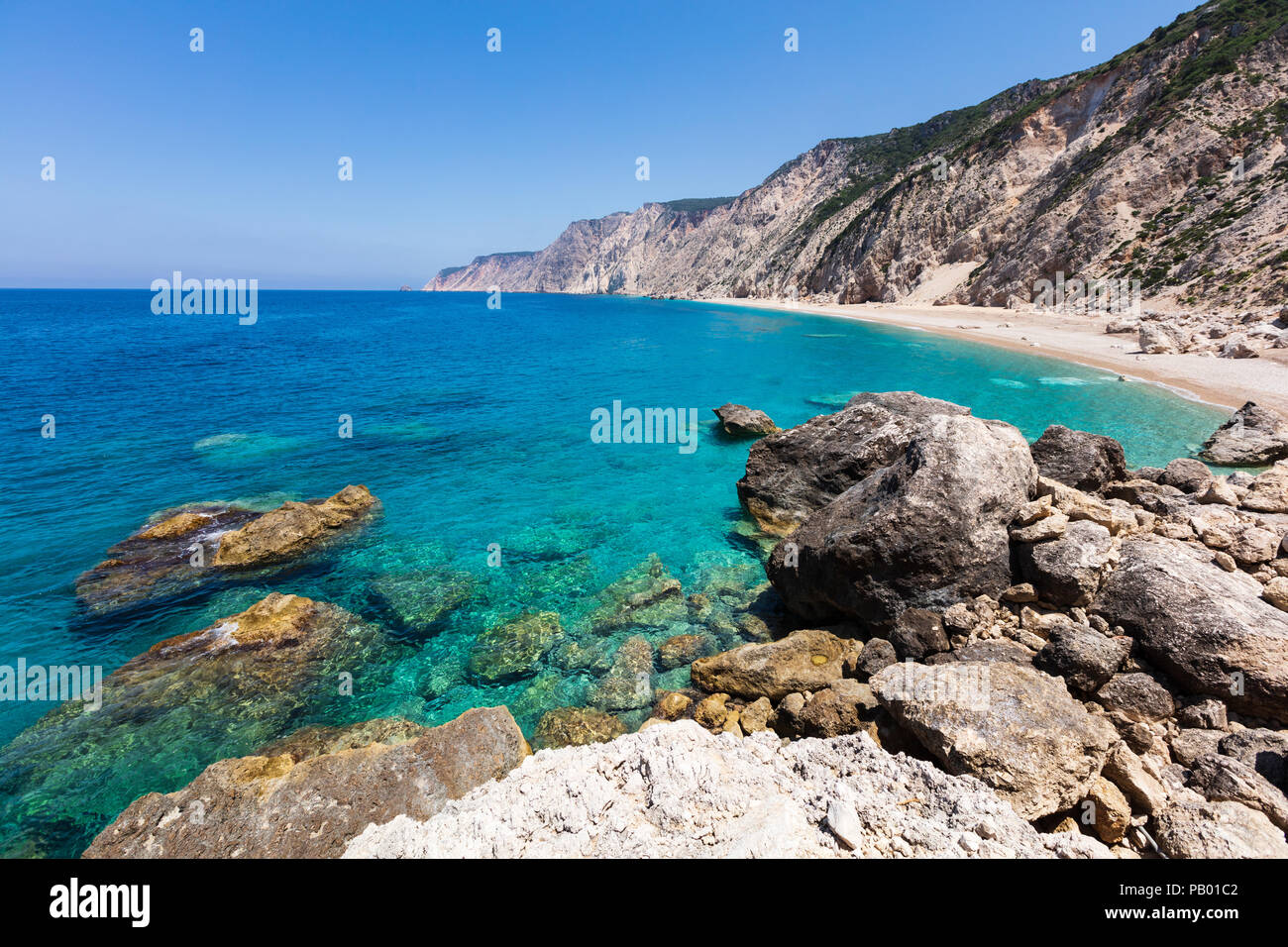View from above to an untouchable beach of an island in Ionian sea - Stock Image