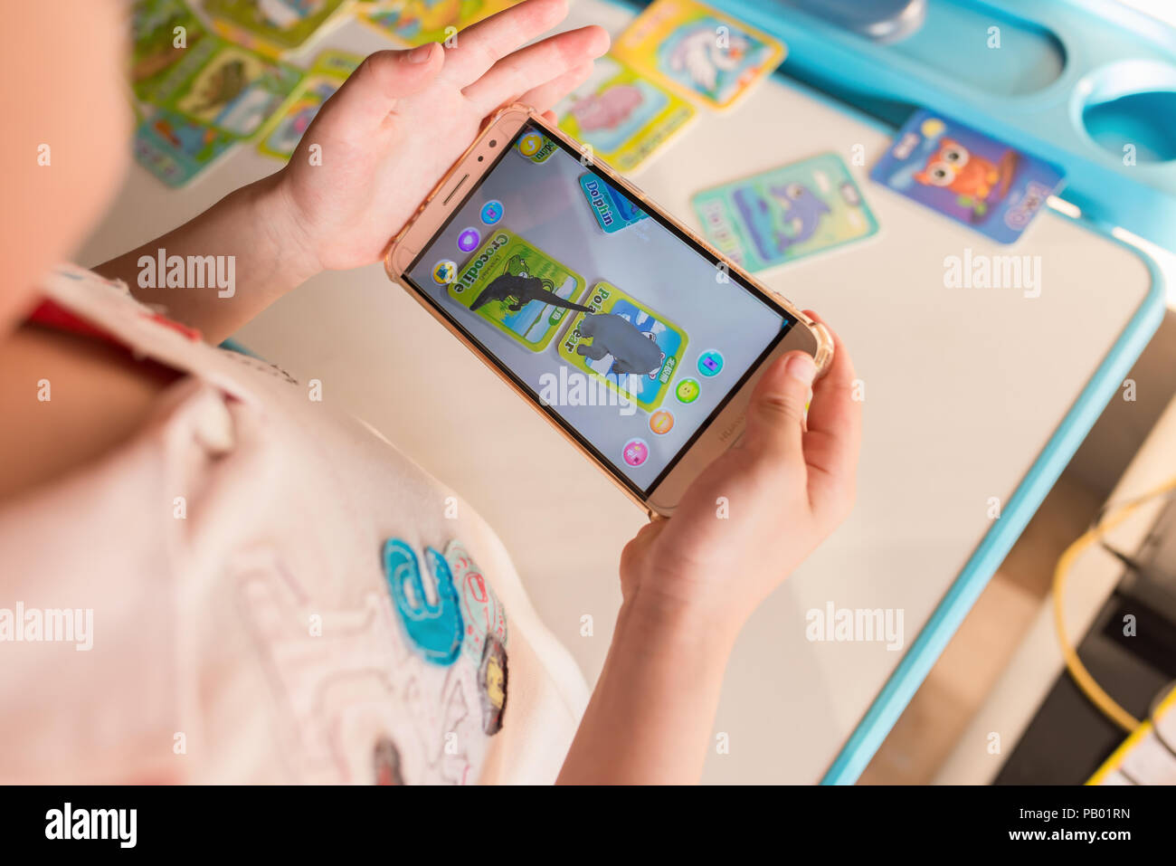 Zhongshan,China-April 22,2018:kid playing Augmented Reality
