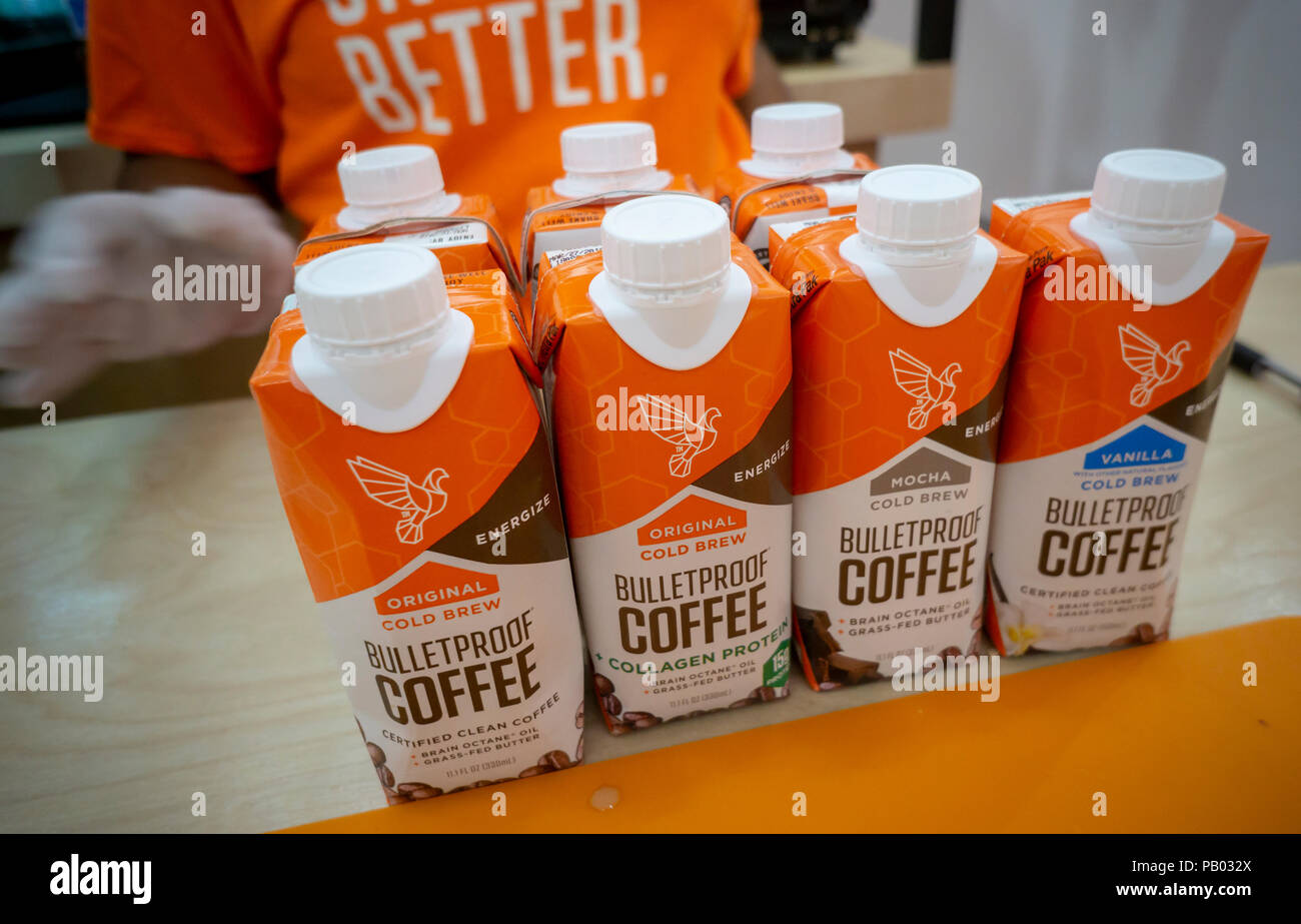 Coffee products on display at the Bulletproof Coffee pop-up branding event in the Soho neighborhood of New York on Thursday, July 12, 2018. Bulletproof, although branded to a specific company, refers to the popular fad among the paleo aficionados of putting butter (or coconut fat, or collagen) in your coffee. (© Richard B. Levine) - Stock Image