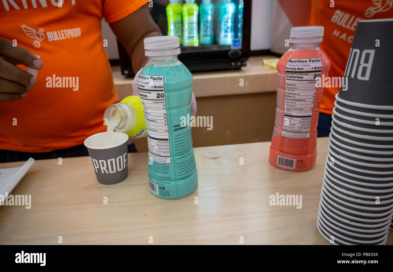Samples of Fat Water, infused with coconut oil, at the Bulletproof Coffee pop-up branding event in the Soho neighborhood of New York on Thursday, July 12, 2018. Bulletproof, although branded to a specific company, refers to the popular fad among the paleo aficionados of putting butter (or coconut fat, or collagen) in your coffee. (© Richard B. Levine) - Stock Image