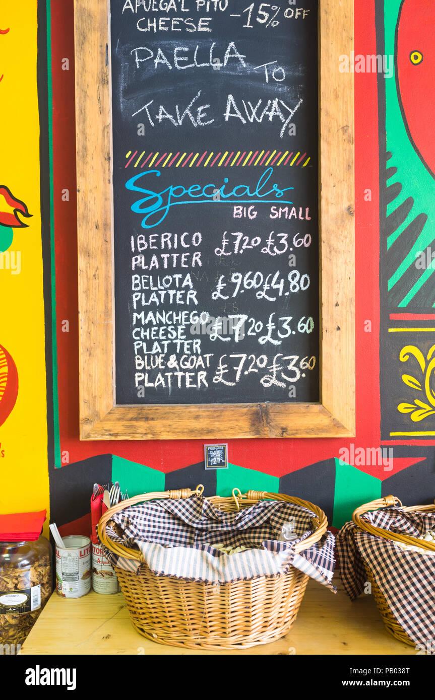 Menu board in a small Spanish delicatessen, UK - Stock Image
