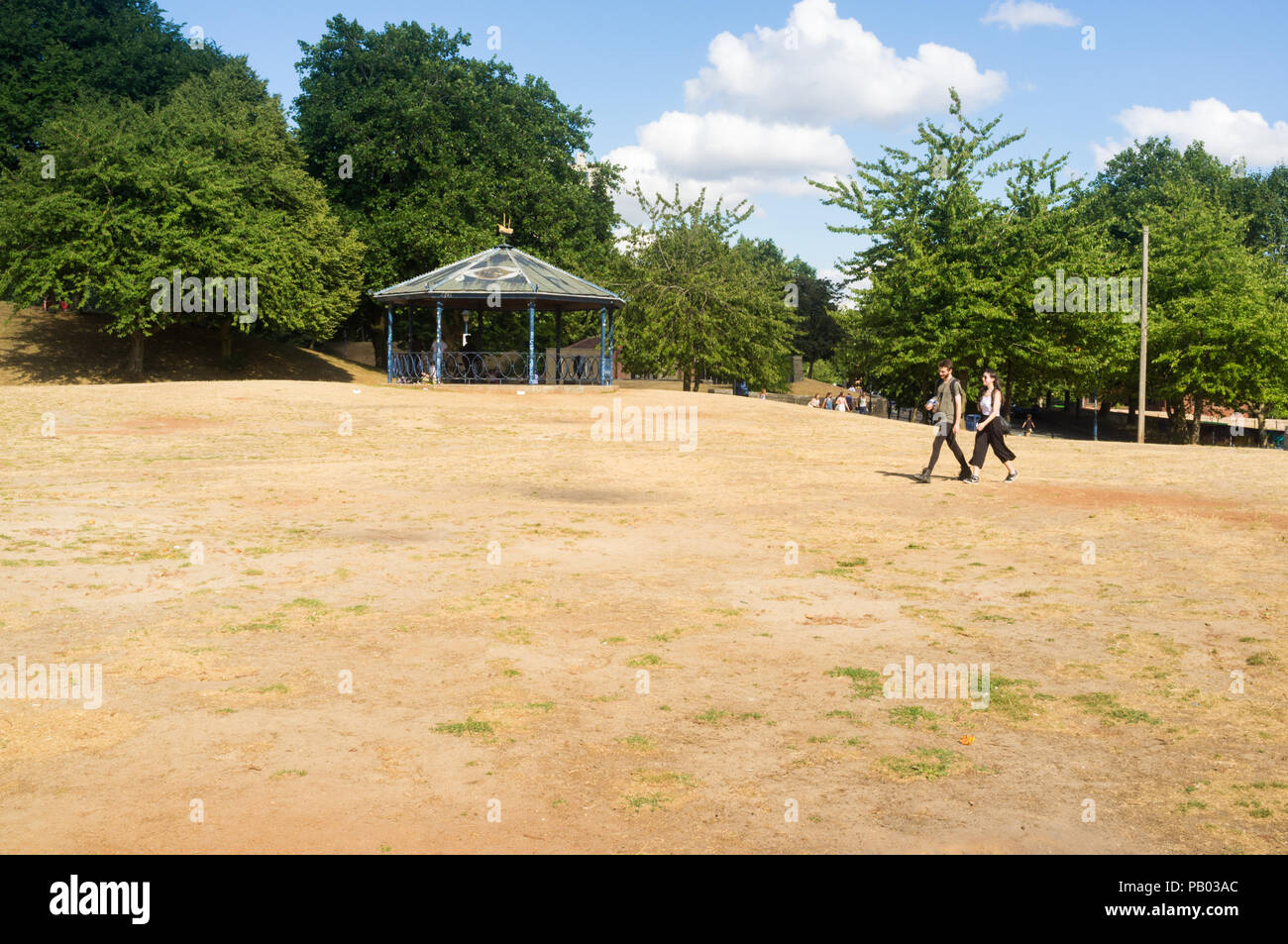 Dry grass in a park in Bristol city, UK, during the 2018 summer heatwave - Stock Image