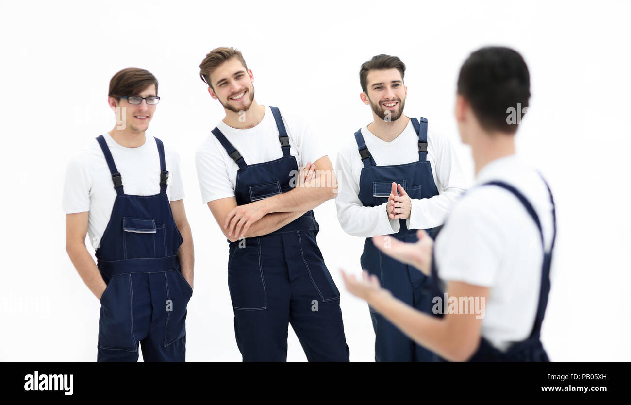 cheerful team of responsible movers and their smiling leader. - Stock Image