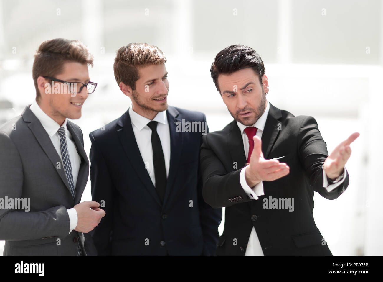 businessman talking to business partners - Stock Image