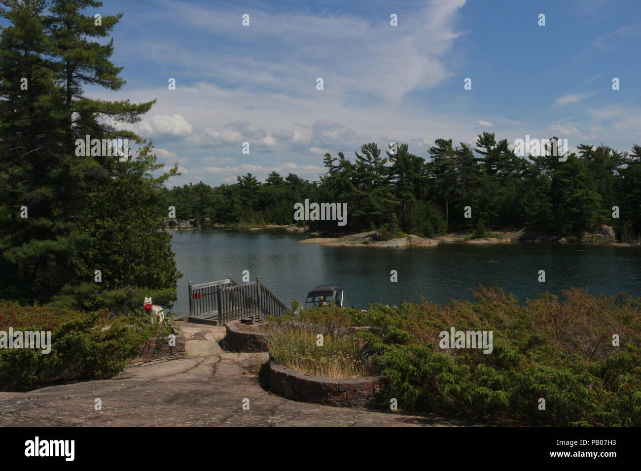 Wide view of cottage country, from a top a lookout tower, brightly colored.. - Stock Image
