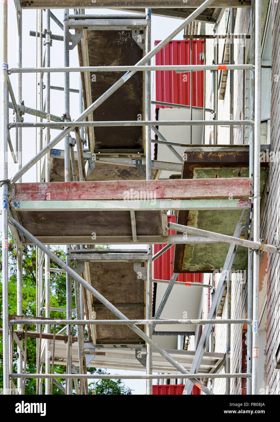 scaffolding, instalatrion of the thermal insulation - Stock Image