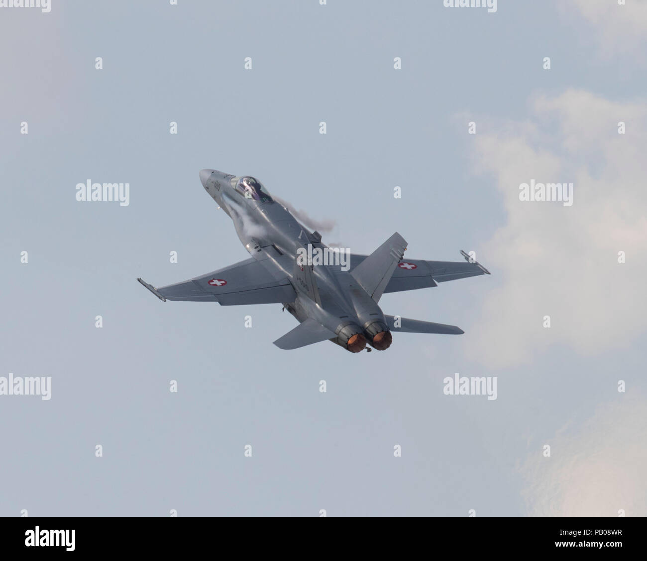 Swiss Air Force Boeing F/A-18C Hornet jet fighter aircraft flying at the 2018 Royal International Air Tattoo - Stock Image