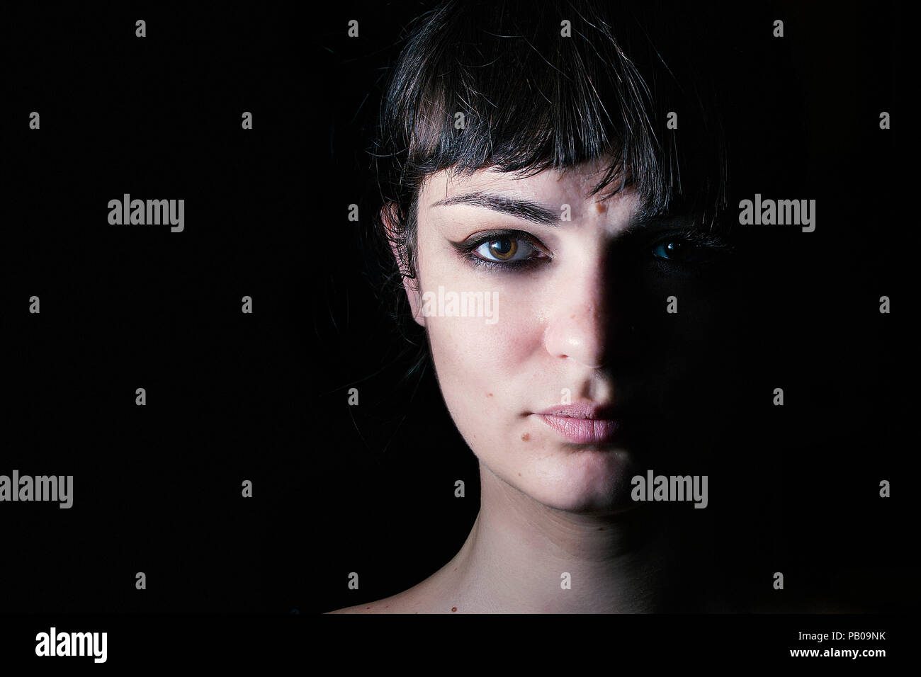 Portrait of a woman in the shadows - Stock Image