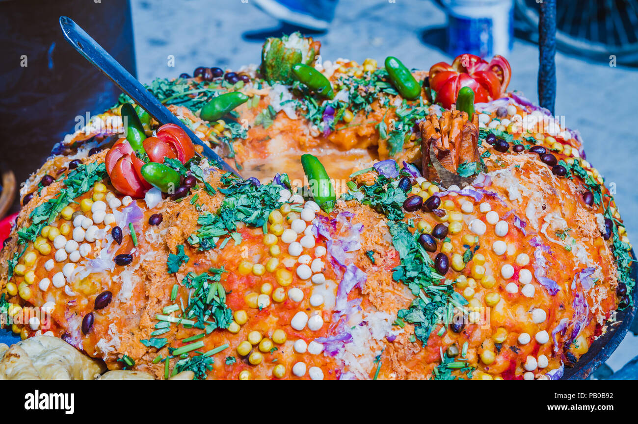 Decorated cooked indian street food ready to serve in the street - Stock Image