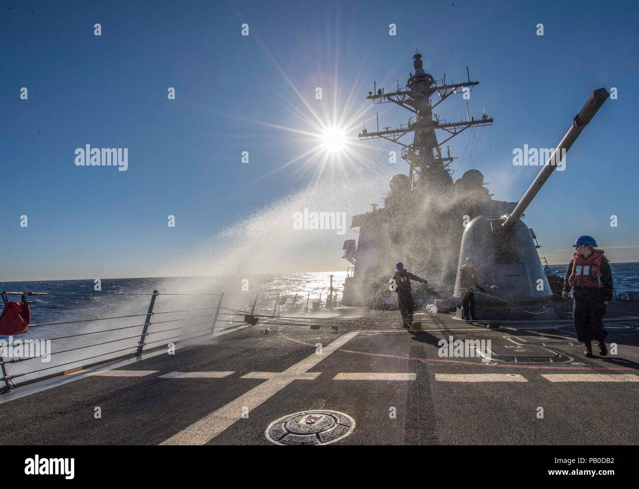 A wave crashes over the forecastle of USS Carney. MEDITERRANEAN SEA (Jan. 22, 2018) A wave crashes over the forecastle of the Arleigh Burke-class guided-missile destroyer USS Carney (DDG 64) while underway in the Mediterranean Sea. Carney is forward-deployed to Rota, Spain, on its fourth patrol in the U.S. 6th Fleet area of operations in support of regional allies and partners, and U.S. national security interests in Europe. Stock Photo