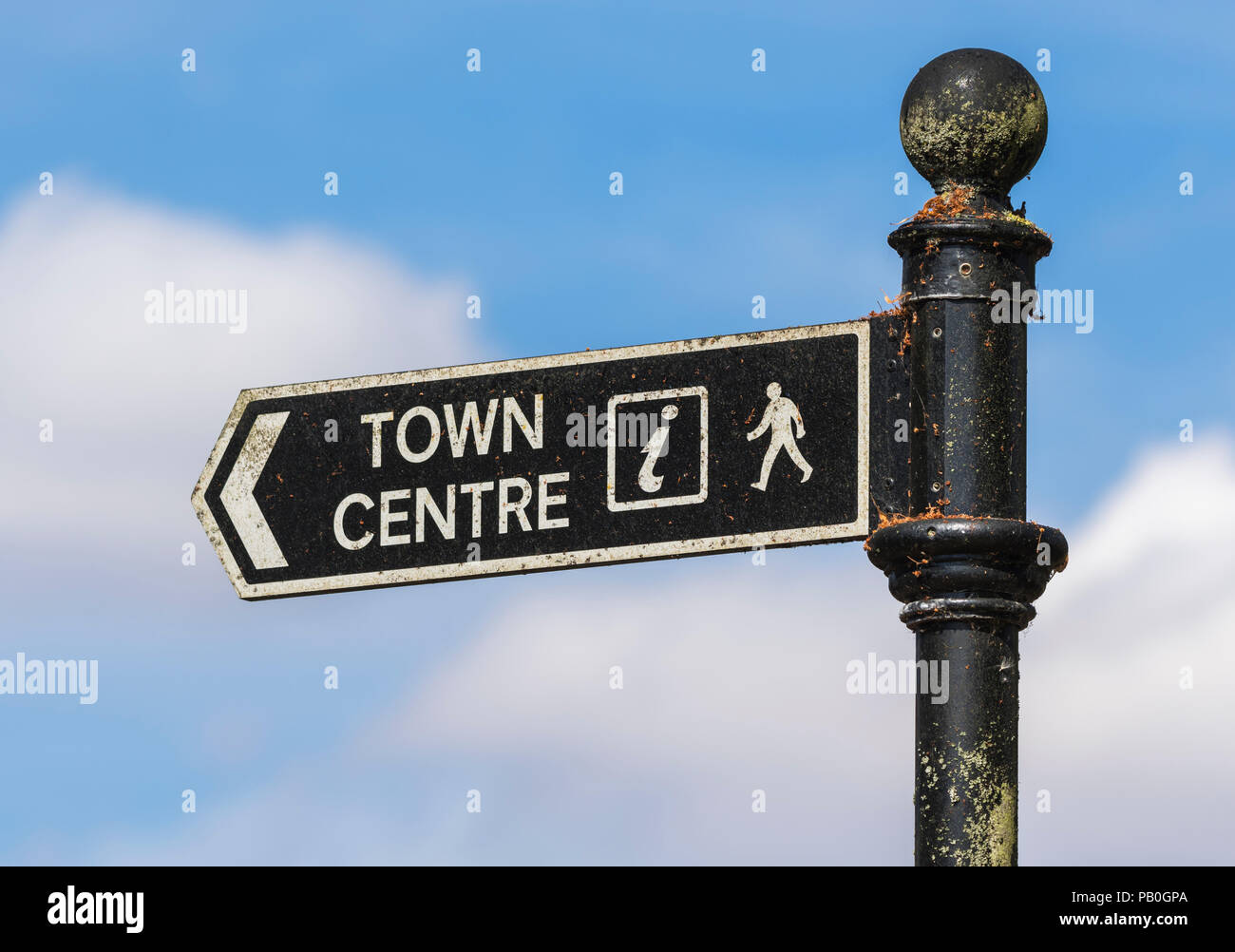 Old decaying and dirty British Town Centre sign. Town centre sign in England, UK. - Stock Image