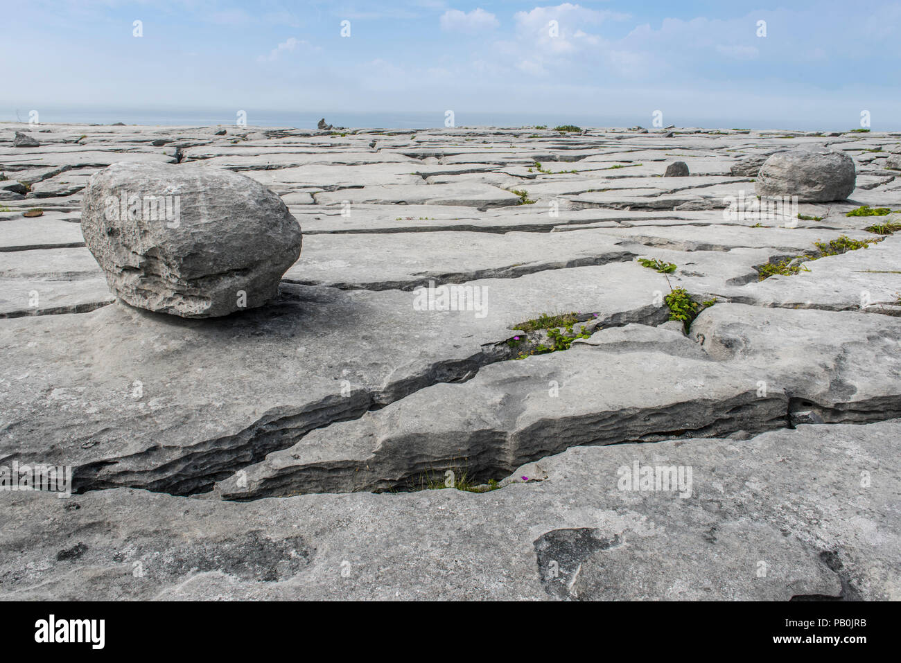 Rocks and columns in Burren karst landscape, Ballyvaughan, County Clare, Republic of Ireland - Stock Image