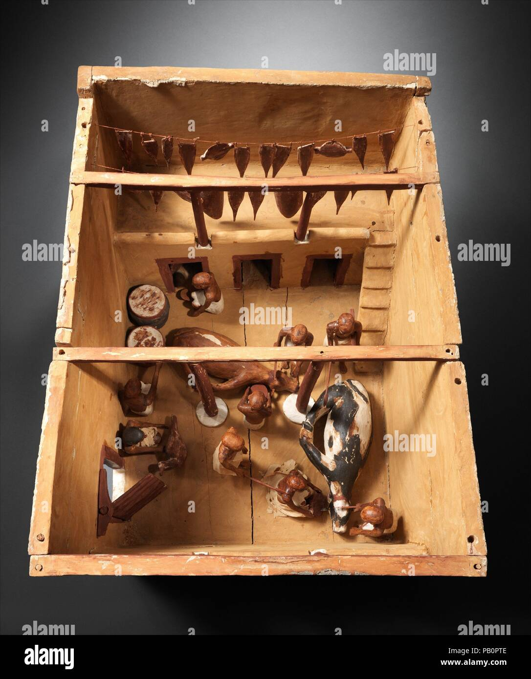 Model of a Slaughter House. Dimensions: L. 76.8 cm (30 1/4 in.); W. 58.5 cm (23 1/16 in.); greatest H. 58.5 cm (23 1/16 in.). Dynasty: Dynasty 12. Reign: early reign of Amenemhat I. Date: ca. 1981-1975 B.C..  This model of a meat processing installation was found with twenty three other models of boats, gardens, and workshops in a hidden chamber at the side of the passage leading into the rock cut tomb of the royal chief steward Meketre, who began his career under King Nebhepetre Mentuhotep II of Dynasty 11 and continued to serve successive kings into the early years of Dynasty 12.  Two oxen a Stock Photo
