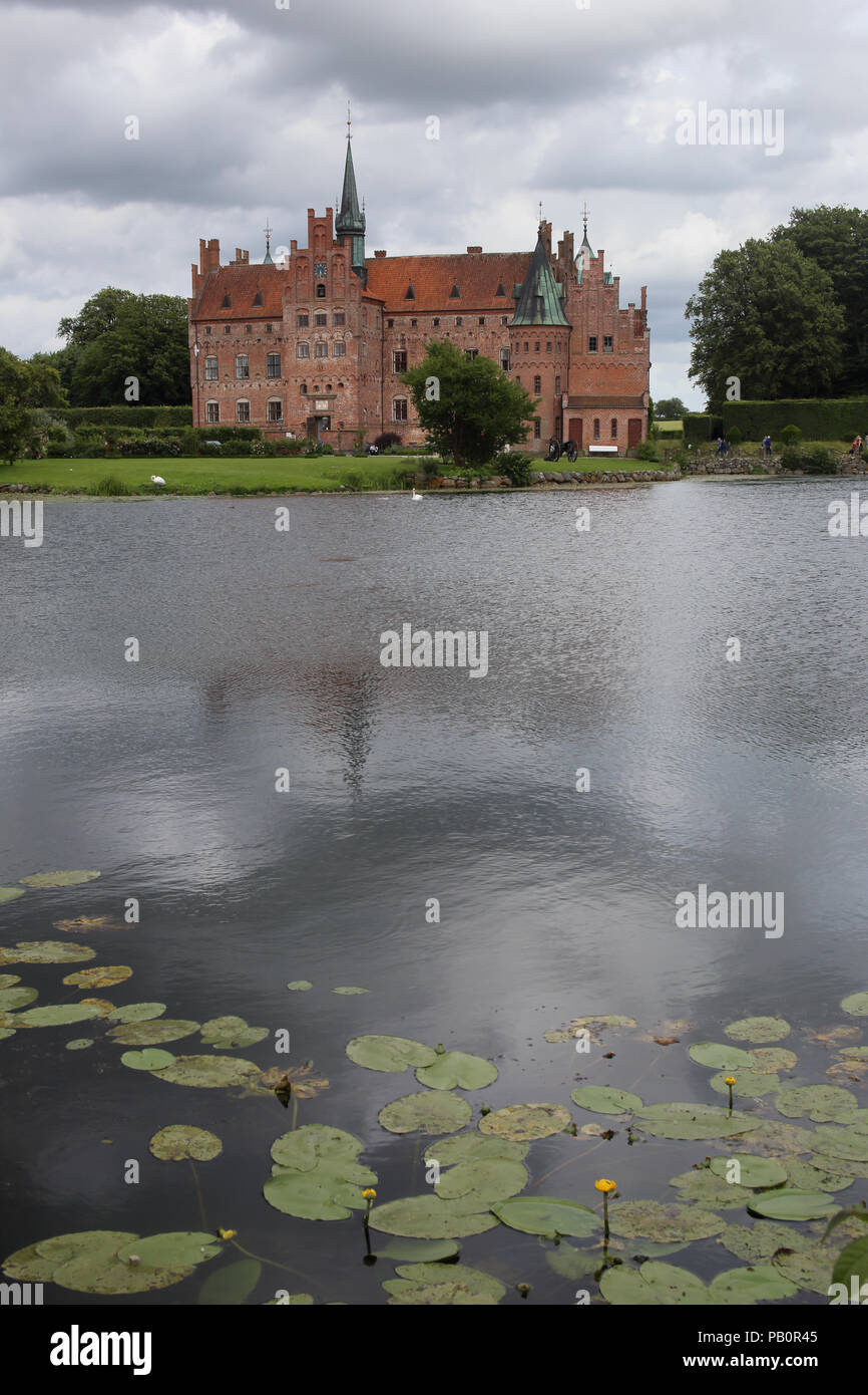 Egeskov Castle on southern Funen in Denmark is one of the best preserved moat castles in Europe. - Stock Image