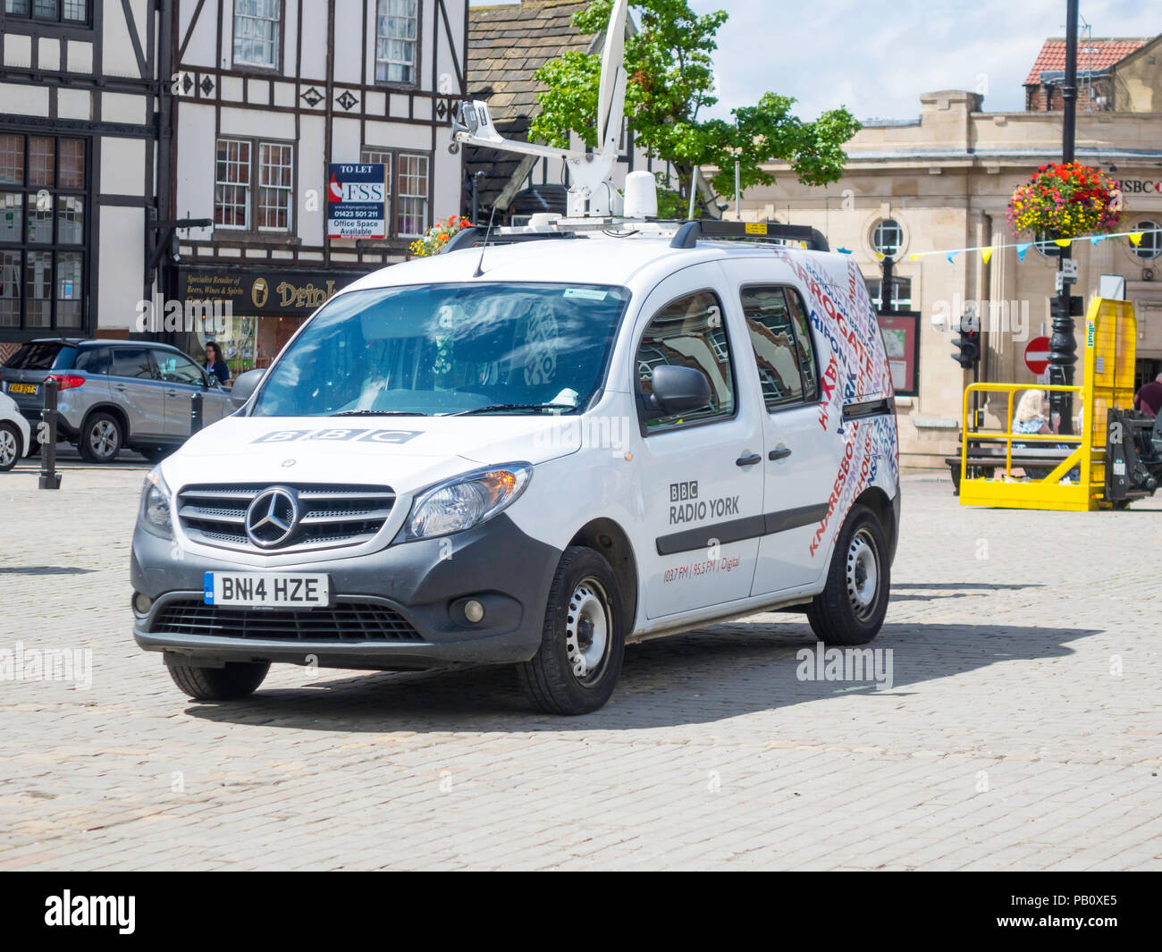 A BBC York reporters van with satellite transmission on assignment in Ripon Market Place North Yorkshire Stock Photo