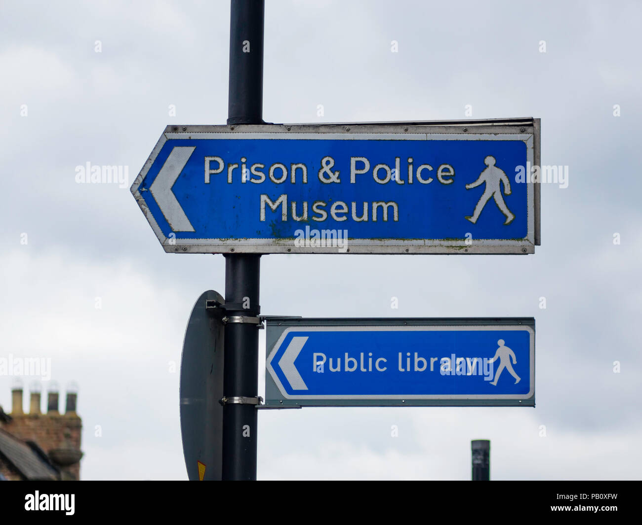 Direction signs in Queen Street Ripon directing pedestrians to the Prison and Police Museum and the Public Library Stock Photo