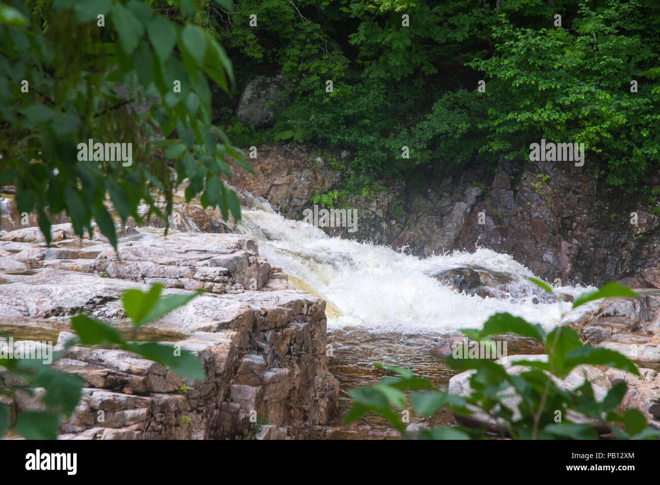 Middle os rushing stream is action based. - Stock Image