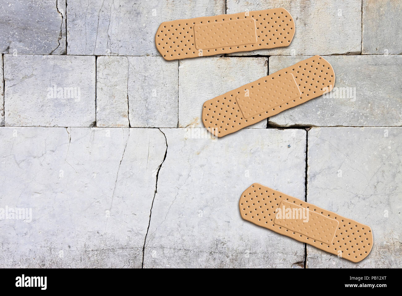 Renovation of an old stone wall- concept image with adhesive bandage - image with copy space - Stock Image