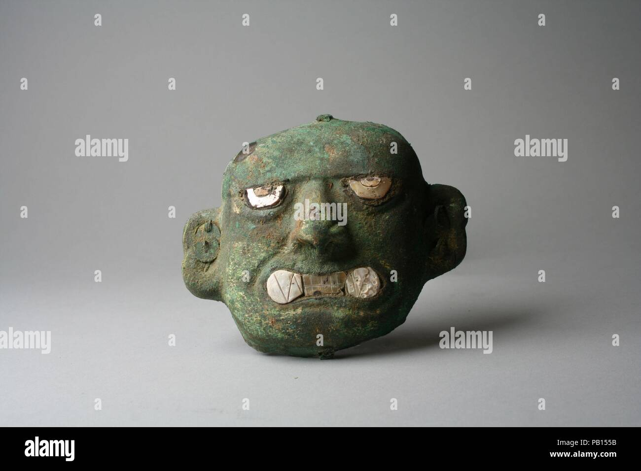 Face Mask Ornament. Culture: Moche (Loma Negra). Dimensions: H x W: 3 3/16 x 3 7/8in. (8.1 x 9.8cm). Date: 390-450. Museum: Metropolitan Museum of Art, New York, USA. Stock Photo
