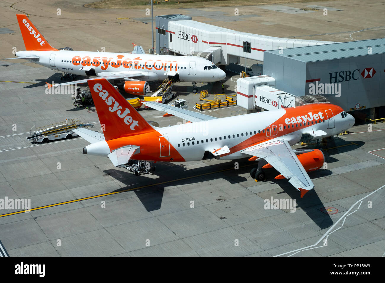 An easyJet Airbus A319 in new livery, and easyJet Airbus A320 in old livery viewing at London Gatwick airport - Stock Image
