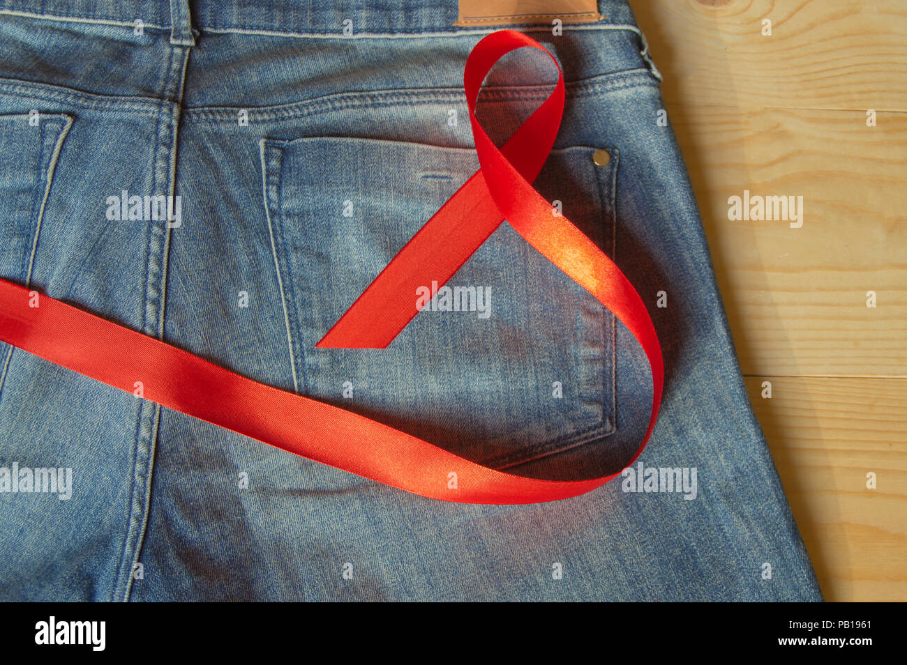 Red ribbon on the Genie is a symbol of struggle and awareness AIDS - Stock Image