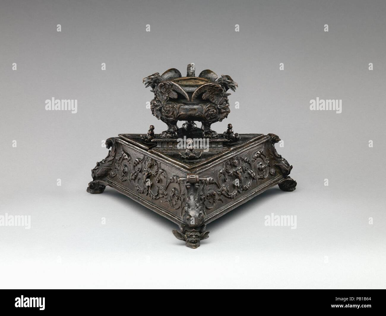 Inkstand. Culture: Italian, probably Padua. Dimensions: Overall (confirmed): 7 1/8 × 11 3/8 × 10 1/4 in. (18.1 × 28.9 × 26 cm)  . 45a (confirmed): 3 1/4 × 11 3/8 × 10 1/4 in. (8.3 × 28.9 × 26 cm)  .45b (confirmed): 4 × 4 1/8 × 4 5/8 in. (10.2 × 10.5 × 11.7 cm)  .45c (confirmed): 1 × 3 3/4 × 3 1/8 in. (2.5 × 9.5 × 7.9 cm)  .45d (confirmed): 1 1/8 × 3 3/4 × 3 1/4 in. (2.9 × 9.5 × 8.3 cm)  .45e (confirmed): 1 × 3 3/4 × 3 1/4 in. (2.5 × 9.5 × 8.3 cm). Date: ca. 1530. Museum: Metropolitan Museum of Art, New York, USA. - Stock Image