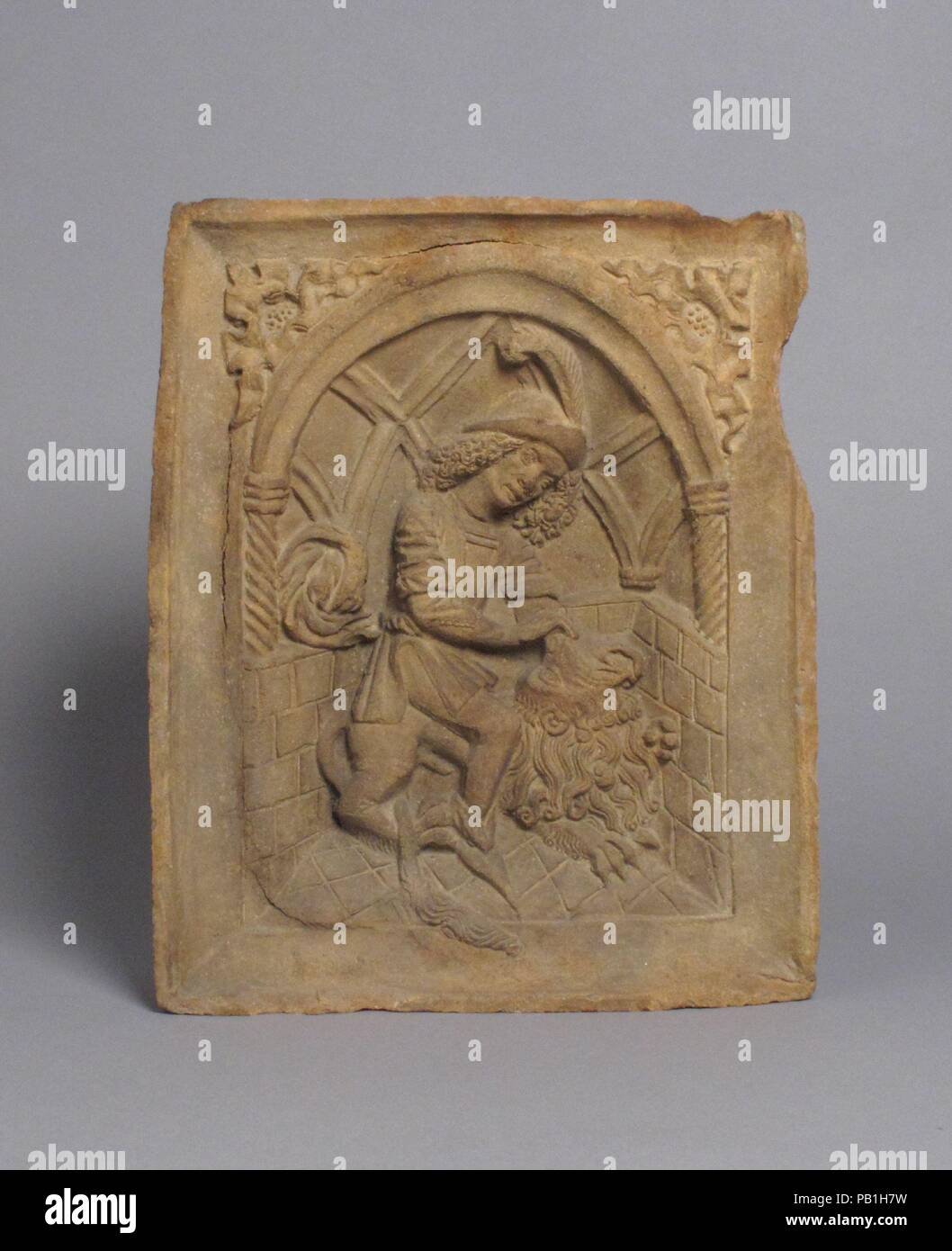 Oven Tile with Samson and the Lion (Based on an Engraving by Master E.S.). Culture: Austrian. Dimensions: Overall: 9 7/8 x 8 1/8 x 2 11/16in. (25.1 x 20.6 x 6.8cm). Date: ca. 1490. Museum: Metropolitan Museum of Art, New York, USA. - Stock Image