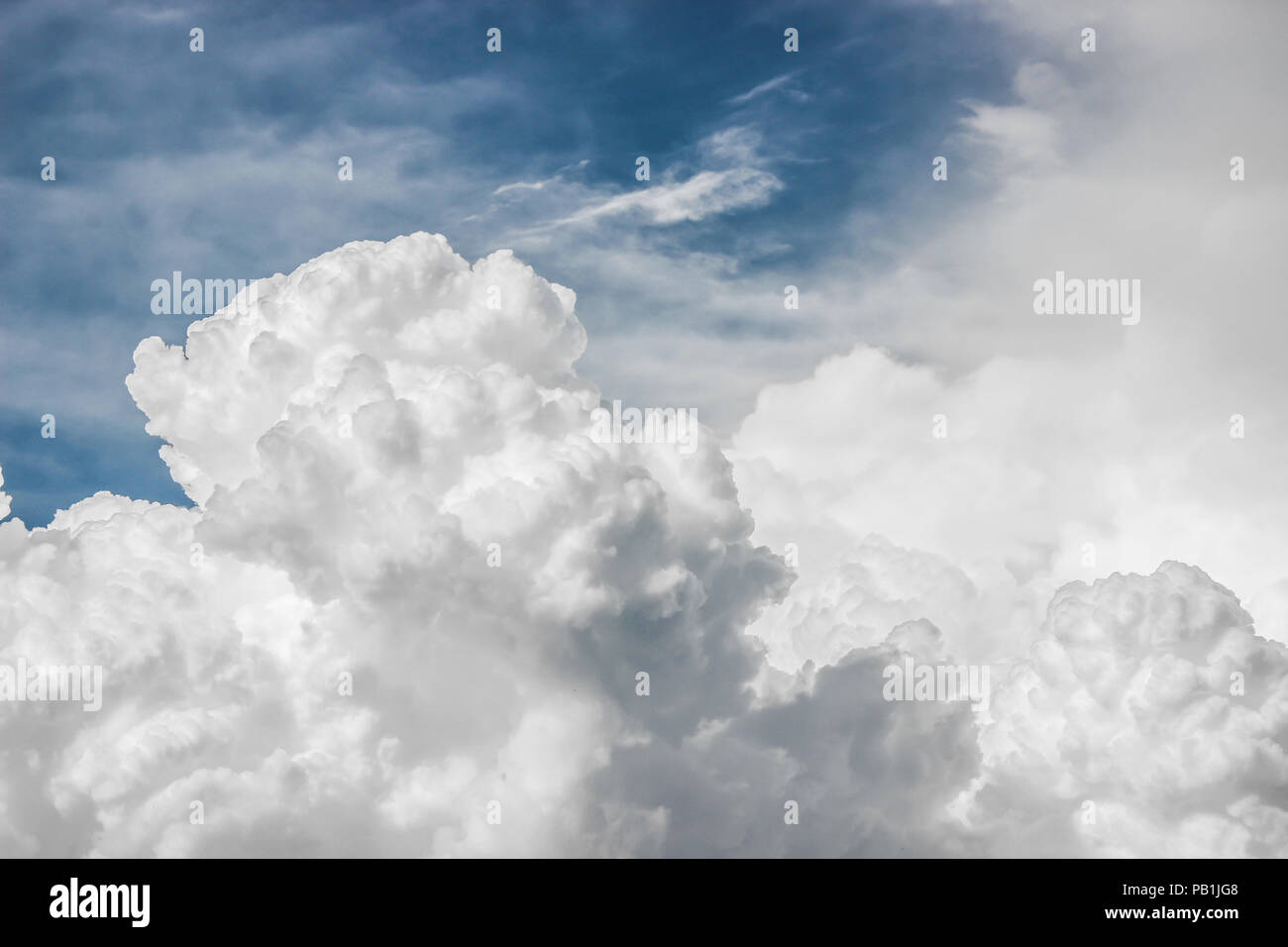 Big puffy clouds - Stock Image