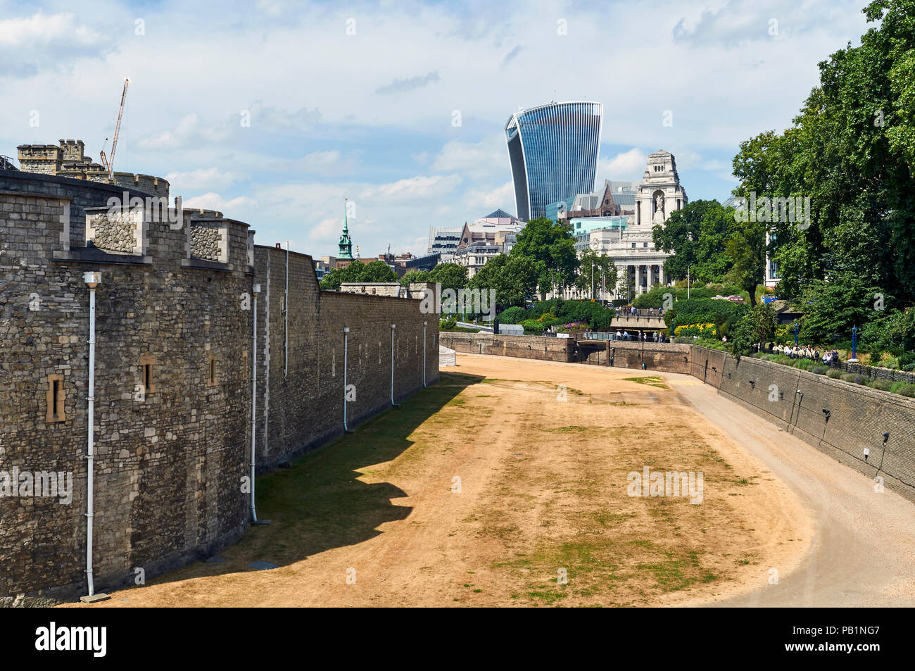 Parched lawns around the Tower of London UK during the 2018 heatwave, with the Walkie Talkie Tower in the background Stock Photo