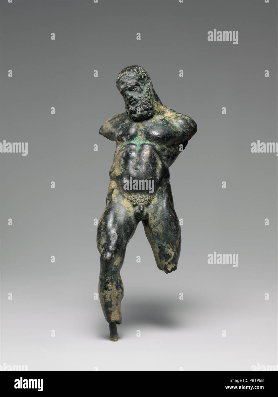 Bronze statuette of drunken Herakles. Culture: Greek. Dimensions: H. 6 1/8 in. (15.60 cm). Date: 3rd-2nd century B.C..  Said to be from Smyrna  The hero lists back, clearly inebriated, his stomach bloated and the muscles of his legs taut as he tries to maintain balance. On analogy with other statuettes of this type, he may have held his club in his left hand and a kantharos (two-handled drinking cup) in his right. Museum: Metropolitan Museum of Art, New York, USA. - Stock Image