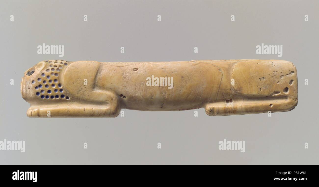 211ec1d7b318 Amulet in the form of a couchant lion. Dimensions  7 8 x 4 1 8 in. (2.2 x  10.6 cm). Date  ca. 2900-2700 B.C.. This small object carved from a piece  of shell ...