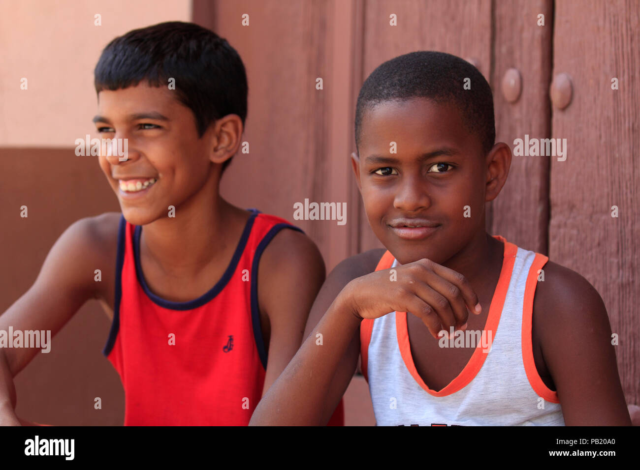 Two young boys sitting in the street, Trinidad, Cuba Stock Photo