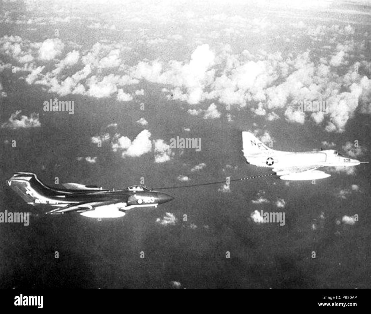 A-4E Skyhawk of VA-55 refuels Sea Vixen FAW2 of 893 NAS in May 1964. - Stock Image