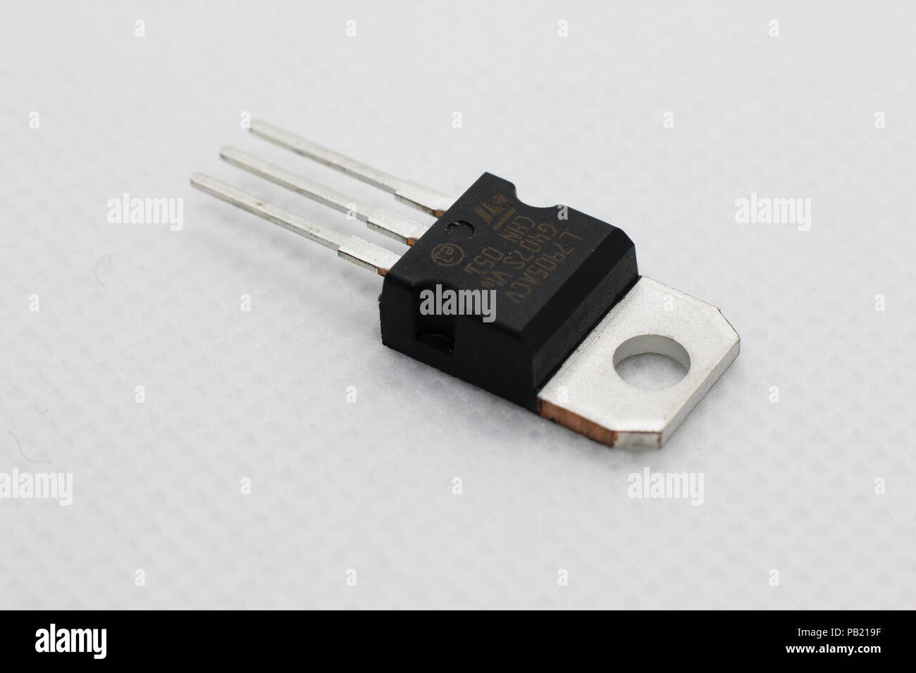 Voltage regulator on white background - Stock Image