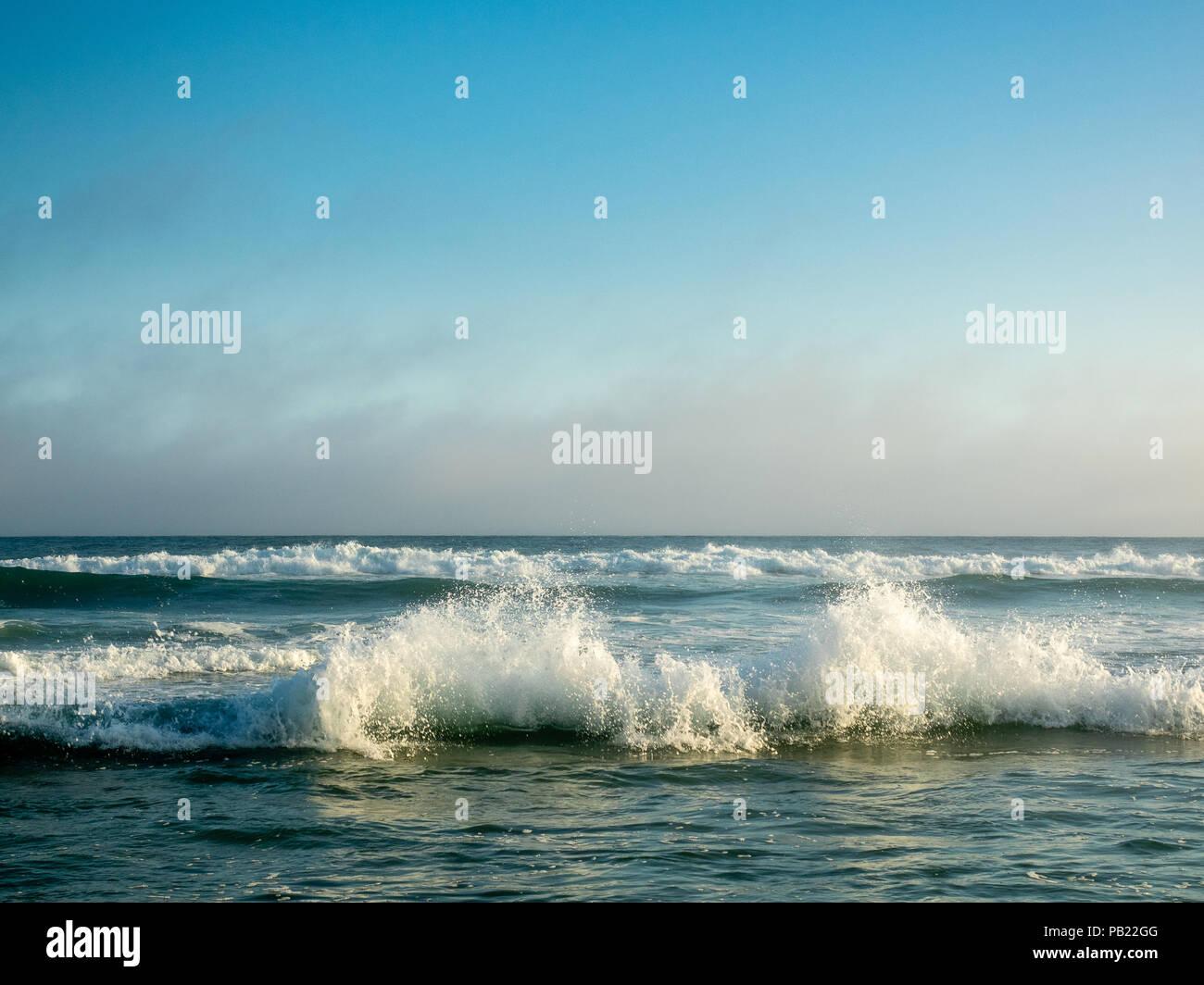Waves crashing on ocean shore, The Hamptons, New York, USA. - Stock Image