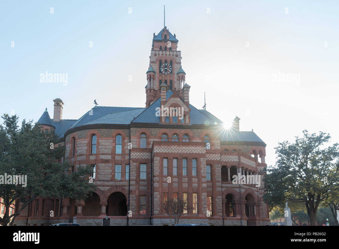 Ellis county courthouse in Waxahachie Texas with sunburst. Constructed in 1897 and designed by Architect J. Riely Gordon in Romanesque Revival Style. - Stock Image
