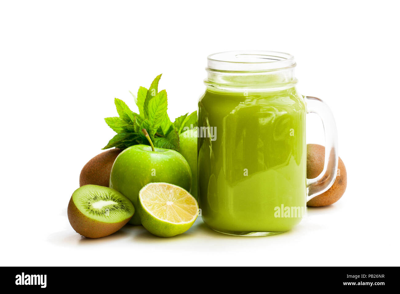 Fresh  smoothie with green fruits in a glass jar mug isolated on white Stock Photo