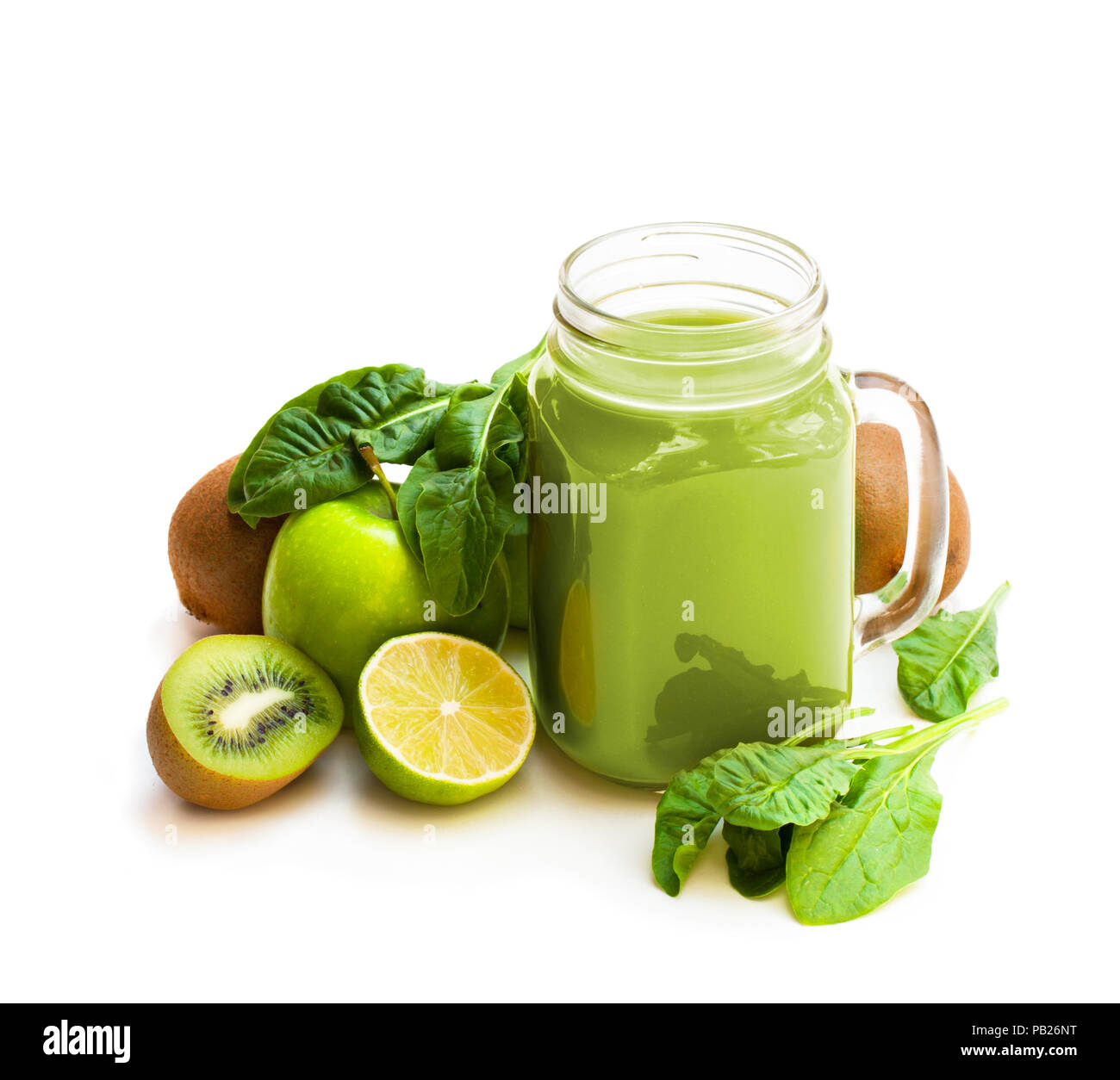Fresh  smoothie with green fruits and spinach in a glass jar mug isolated on white Stock Photo